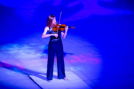 Orlando, Florida . November 23, 2019. Woman violinist playing holiday music on Seaworlds Christmas Celebration (10)