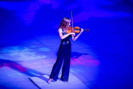 Orlando, Florida . November 23, 2019. Woman violinist playing holiday music on Seaworlds Christmas Celebration (2)