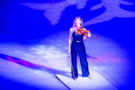 Orlando, Florida . November 23, 2019. Woman violinist playing holiday music on Seaworlds Christmas Celebration (15)