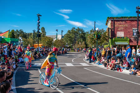 Girls riding colorful bicycles in Sesame Street Party Parade at Seaworld 2