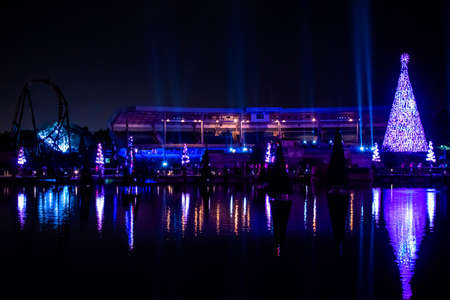 Orlando, Florida. December 27, 2019. Illuminated and colorful Sea of Christmas Trees and partial view of Bayside Stadium at Seaworld 107