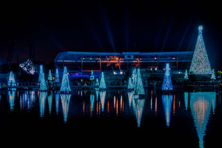 Orlando, Florida. December 27, 2019. Illuminated and colorful Sea of Christmas Trees and partial view of Bayside Stadium at Seaworld 108