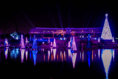 Orlando, Florida. December 27, 2019. Illuminated and colorful Sea of Christmas Trees and partial view of Bayside Stadium at Seaworld 109