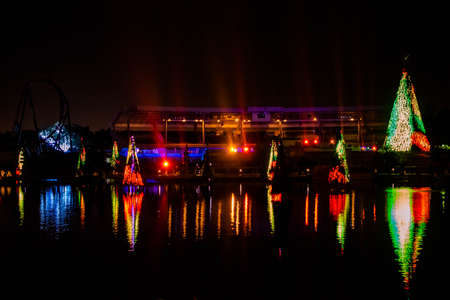 Orlando, Florida. December 27, 2019. Illuminated and colorful Sea of Christmas Trees and partial view of Bayside Stadium at Seaworld 110