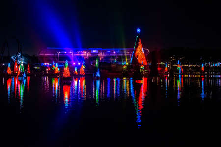 Orlando, Florida. December 30, 2019. Illuminated and colorful Sea of Christmas Trees with light rays on background at Seaworld 18 Redactioneel