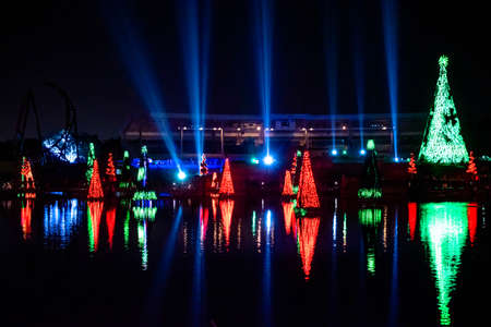 Orlando, Florida. December 30, 2019. Illuminated and colorful Sea of Christmas Trees with light rays on background at Seaworld 25