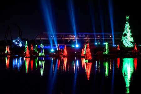 Orlando, Florida. December 30, 2019. Illuminated and colorful Sea of Christmas Trees with light rays on background at Seaworld 27