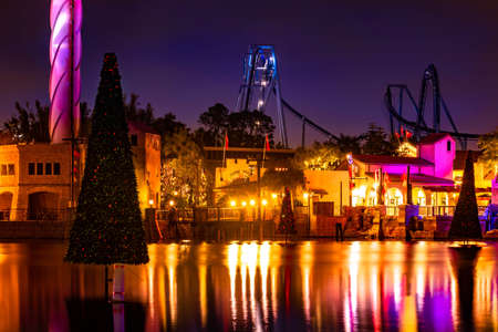Orlando, Florida. December 30, 2019. Sky Tower, Manta Ray and Christmas trees on colorful lake at Seaworld