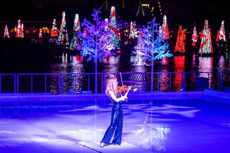 Orlando, Florida. December 30, 2019. Woman violinist in Winter Wonderland on Ice at Seaworld 4