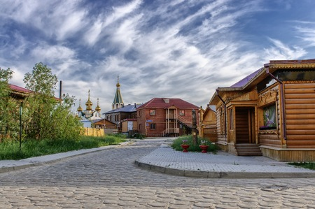 Wooden buildings and road at old town, Yakutsk, Russia.