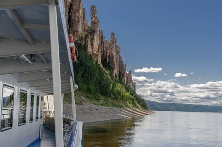 A travel boat arrived to National heritage of Russia Lena Pillars placed in republic Sakha, Siberia. View from a boat Stock Photo