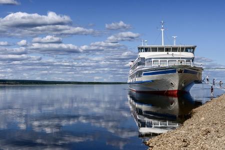 Passenger boat moored to a river Lena bank, Lena Pillars National Park, Yakutia