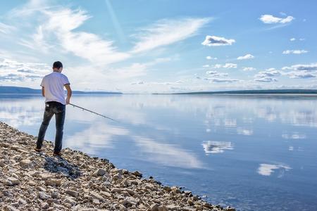 lena: Man fishing on the river Lena, Yakutia Stock Photo