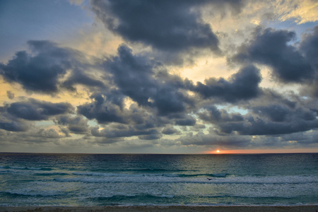Caribbean beach at Cancun, Mexico, very early in the morning time, sunrise