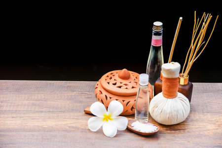 Spa massage compress balls, herbal ball on the wooden with treaments spa , Thailand, soft and select focus Stock Photo