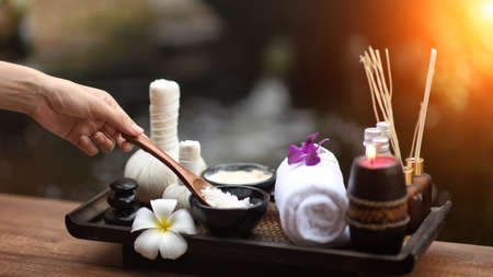 Spa massage compress balls, herbal ball on the wooden with treaments spa; Thailand, soft and select focus