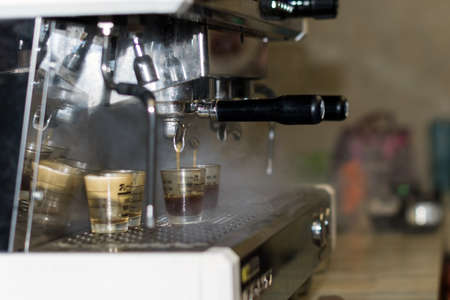 Close up the  machine is preparing grind coffee beans to make coffee in coffee machine.