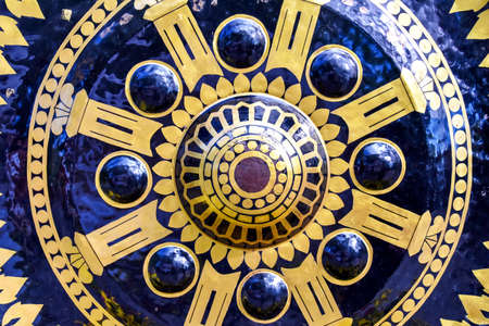 Patterns of gong; beautiful texture is from Thai pattern gong in Buddhism temple. It is yellow and black. Archivio Fotografico