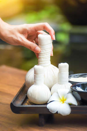 Spa herbal compressing ball , white frangipani flowers.