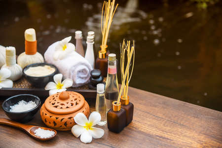 Spa massage compress balls, herbal ball on the wooden with treaments spa , Thailand, soft and select focus Archivio Fotografico