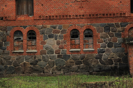 the old brick house, wall with four windows photo