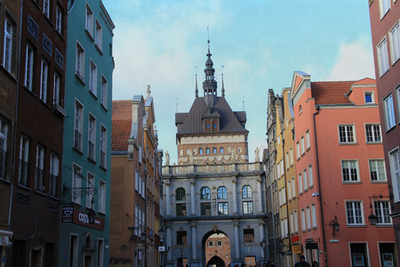 conducts: the bright city street with cafe and shops conducts to the beautiful arch leaving to a cathedral