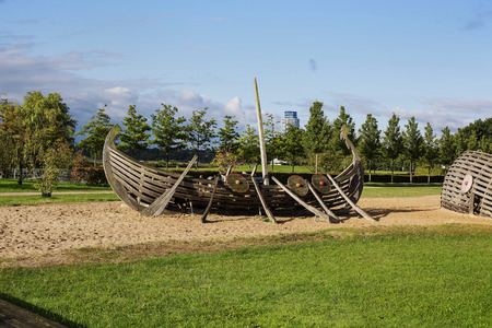 rockclimber: the decoration of the Park in the form of a Viking ship on the background of trees and lakes