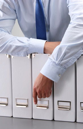 categorize: Close-up of the businessman with office folders.