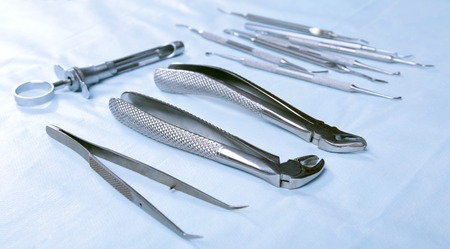 otorhinolaryngologist: Medical instruments for dentists on blue table