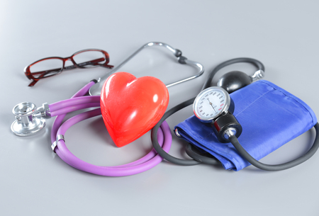 otorhinolaryngology: Medical instruments, stethoscope and red heart for ENT
