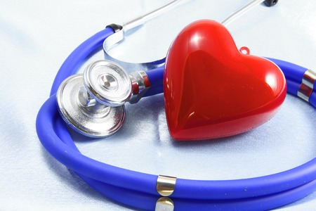 scratcher: Medical instruments, stethoscope and red heart closeup shot.