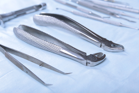 scratcher: Medical instruments for dentists on blue table. Stock Photo