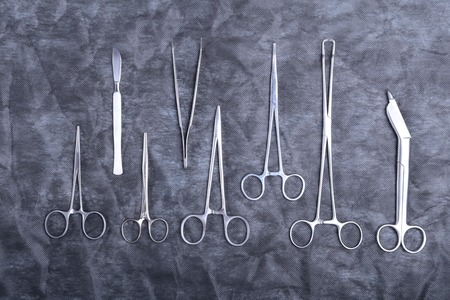 otorhinolaryngology: Medical instruments for dentists on blue table. Stock Photo
