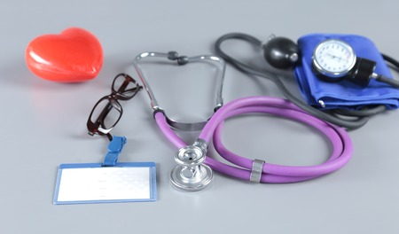 Red heart and a stethoscope on desc. Stock Photo