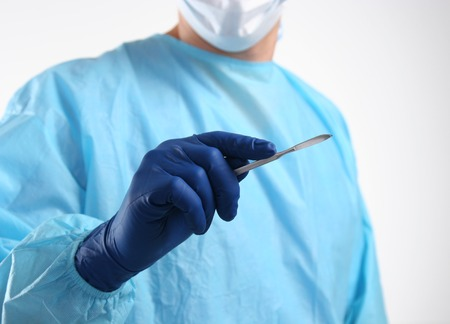 resuscitate: Surgeon hand hold scalpel and tweezers while cut and cure wound closeup. Resuscitation and or, injury heal, medic shop or store, saving patient, 911, surgery and emergency, put stitch concept