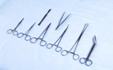 surgical tray: Medical instruments in a steel tray . scalpel