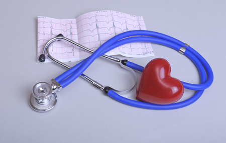 Stethoscope and medical equipment on a light background.