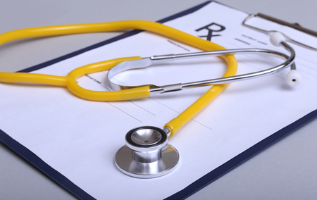 clean lungs: Stethoscope and medical equipment on a light background.