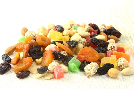 shvat: Mix of dried fruits and nuts on dark wood background with copy space. Symbols  judaic holiday Tu Bishvat