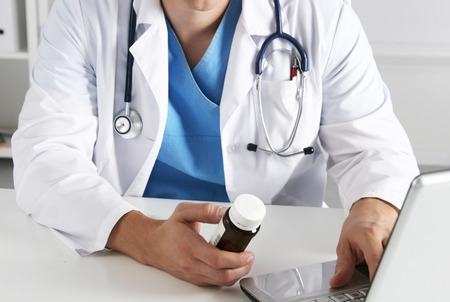 Hand of doctors holding many different pills Stock Photo