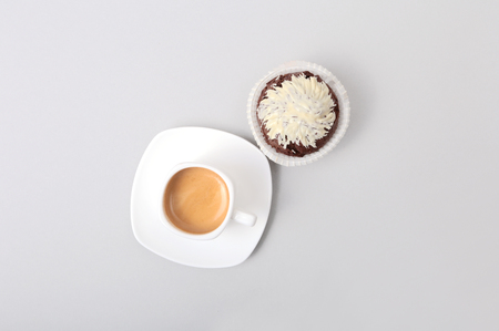 Classic style espresso shot with chip muffin and coffee beans on white background. Stock Photo