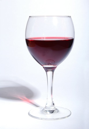 Isolated Glass of red wine on white background.