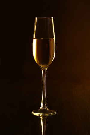 Isolated Glass of white wine on black background. Stock Photo