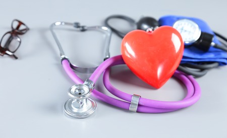 Red heart, stethoscope and medical equipmenton on white background Stock Photo
