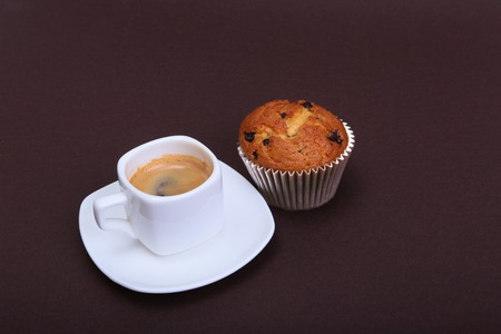 Classic espresso in white cup with cake and chocolate. Stock Photo