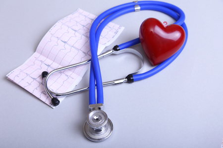 RX prescription, Red heart and a stethoscope on white background