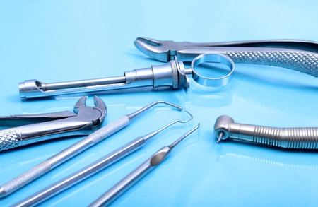 Set of metal medical equipment tools for teeth dental care. Stock Photo