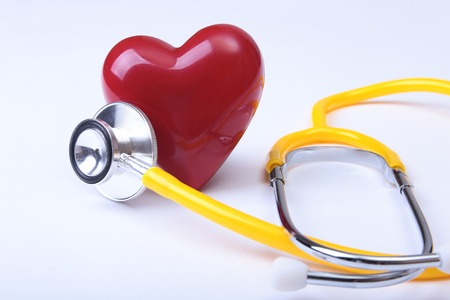Medical stethoscope and red heart isolated on white Stock Photo