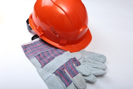 claw hammer: Orange hard hat, safety glasses, gloves and measuring tape on white isolated