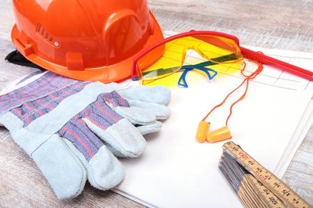 Orange earplug , hard hat, safety glasses, gloves. Earplug to reduce noise on a white background .